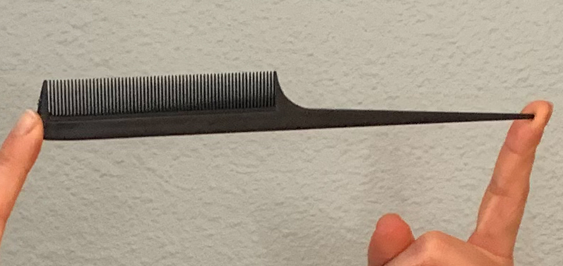 Black fine toothed comb with a tapered handle