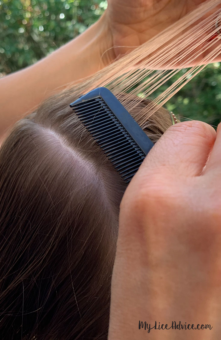 Blond hair being moved to the other side in sections