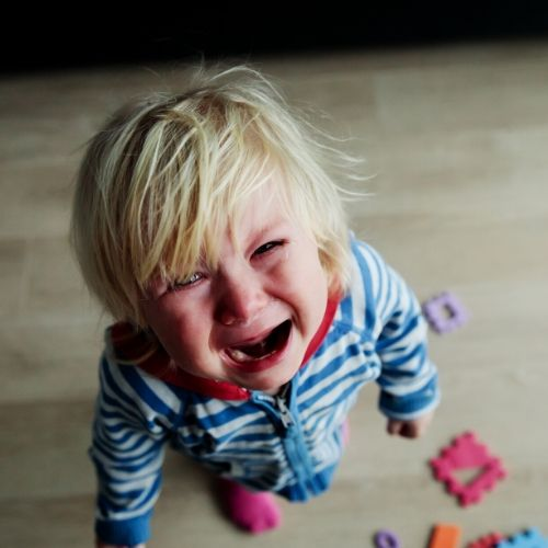 A blond child is crying