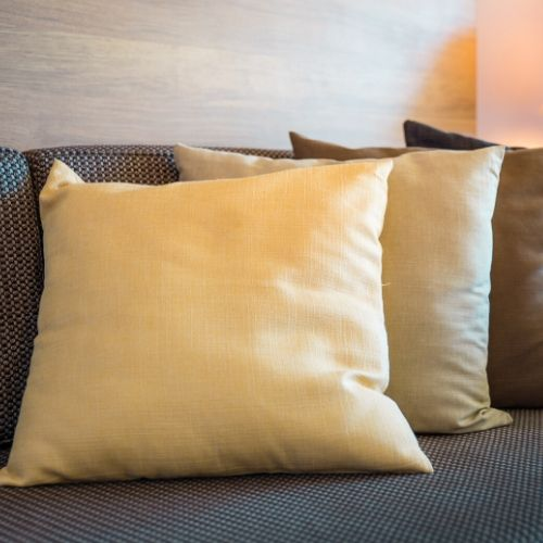 Three Throw Pillows on a couch