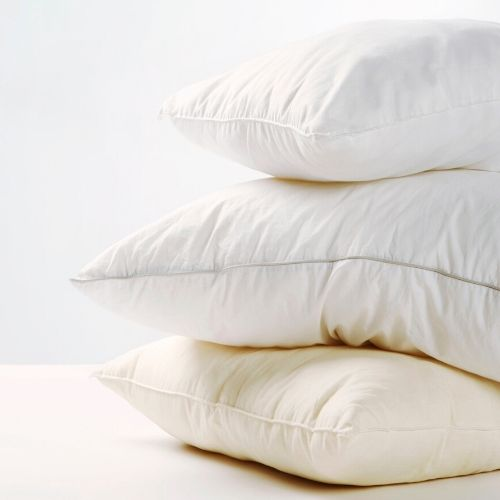 3 white pillows stacked on each other.